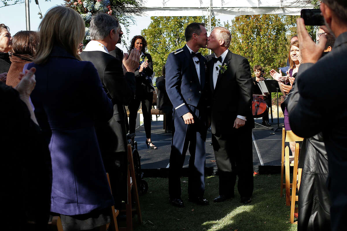 Vic Holmes, left, and Mark Phariss kiss at the conclusion of their marriage ceremony in Frisco on Saturday, Nov. 21, 2015.