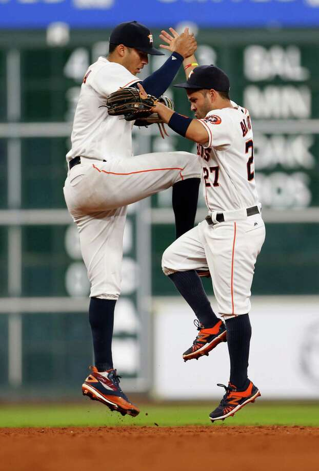Halfway through  the season, Astros shortstop Carlos Correa, left, has driven in a team-high 51 runs. Many of those RBIs helped second baseman Jose Altuve score a team-best 62 times. Photo: Karen Warren, Staff / © 2016 Houston Chronicle
