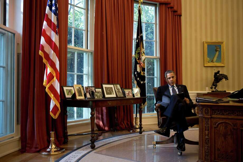 """A self-proclaimed """"night guy,"""" President Barack Obama has come to see the long, solitary hours after dark as essential to him as his time in the Oval Office.  Photo: DAMON WINTER, STF / NYTNS"""