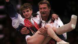 When Bela Karolyi reflects on his role in the sport since the 1960s, he recalls some of the great gymnasts he has coached. They include Kerri Strug, above, as she completed her 1996 Olympics run injured en route to a U.S. team gold medal and Mary Lou Retton, left, whose perfect scores in 1984 helped make her the first U.S. gymnast to win the individual all-around gold.
