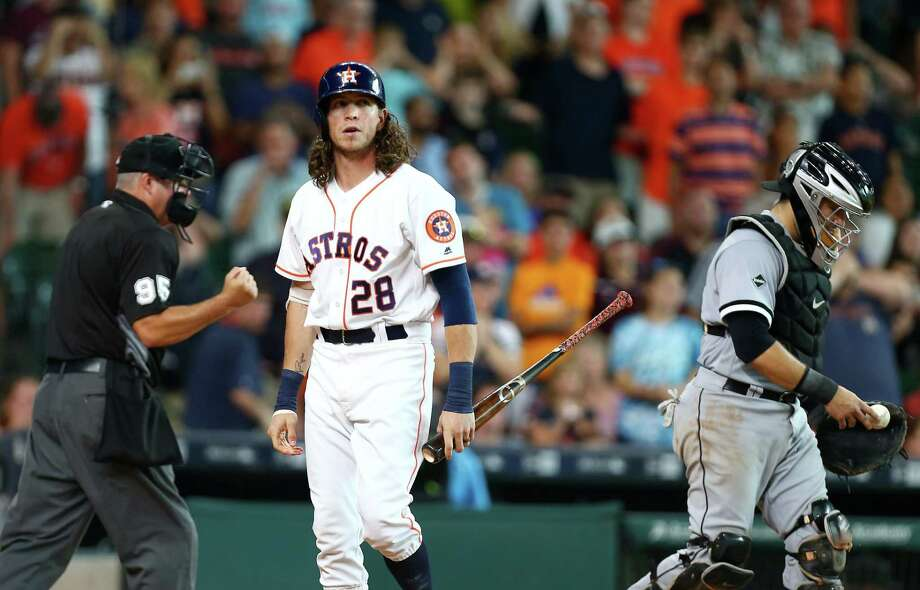The Astros' hopes were snuffed out in the ninth inning when outfielder Colby Rasmus, who was a pinch hitter representing the tying run, struck out against White Sox reliever David Robertson to end Saturday's game. Plate umpire Tim Timmons makes the call. Photo: Jon Shapley, Staff / © 2015  Houston Chronicle