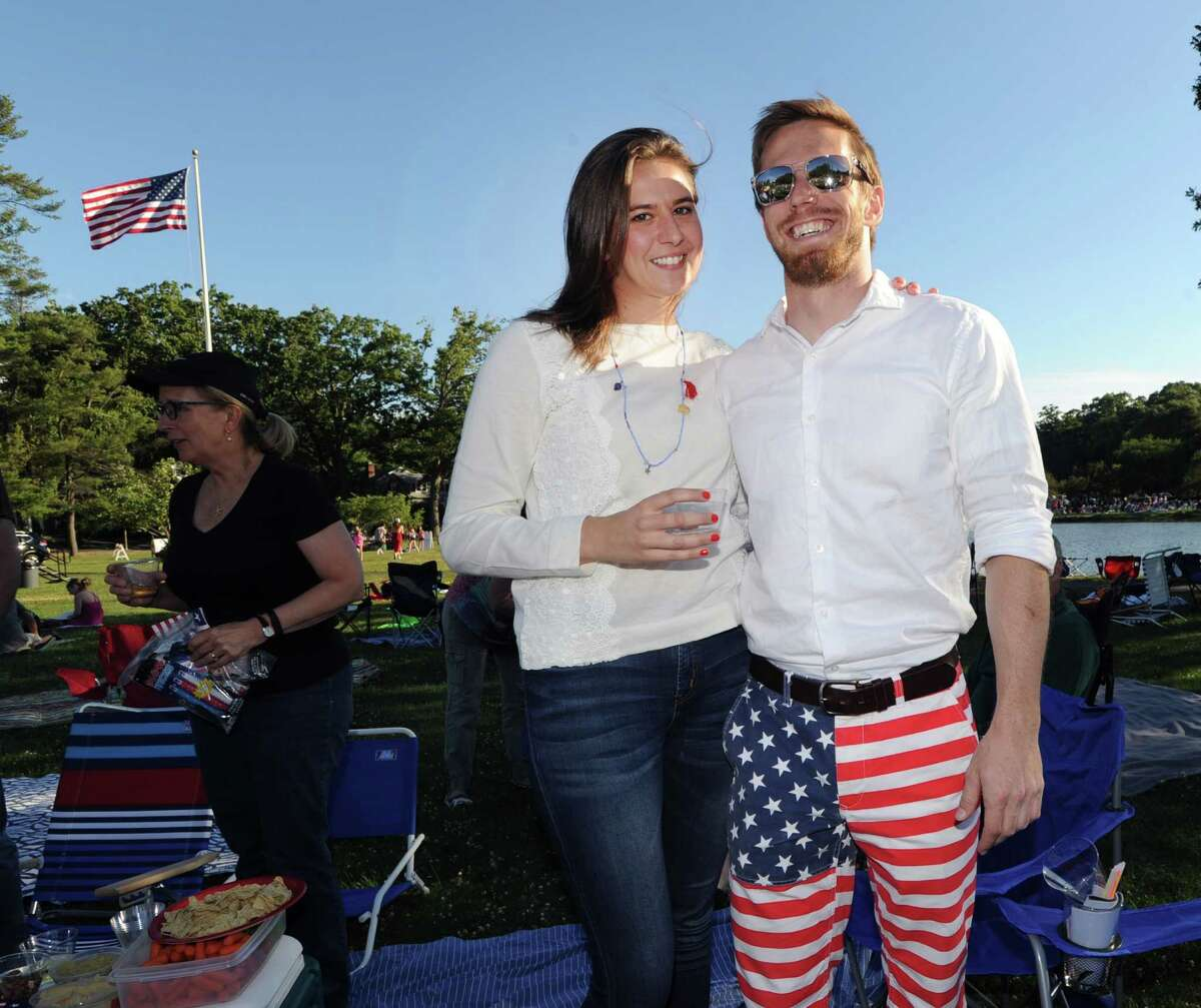 Jamie Robins with his All-American pants and Julie Pearson, both of New York City, during the Town of Greenwich 4th of July fireworks display and celebration at Binney Park in Old Greenwich, Conn., Saturday night, July 2, 2016.