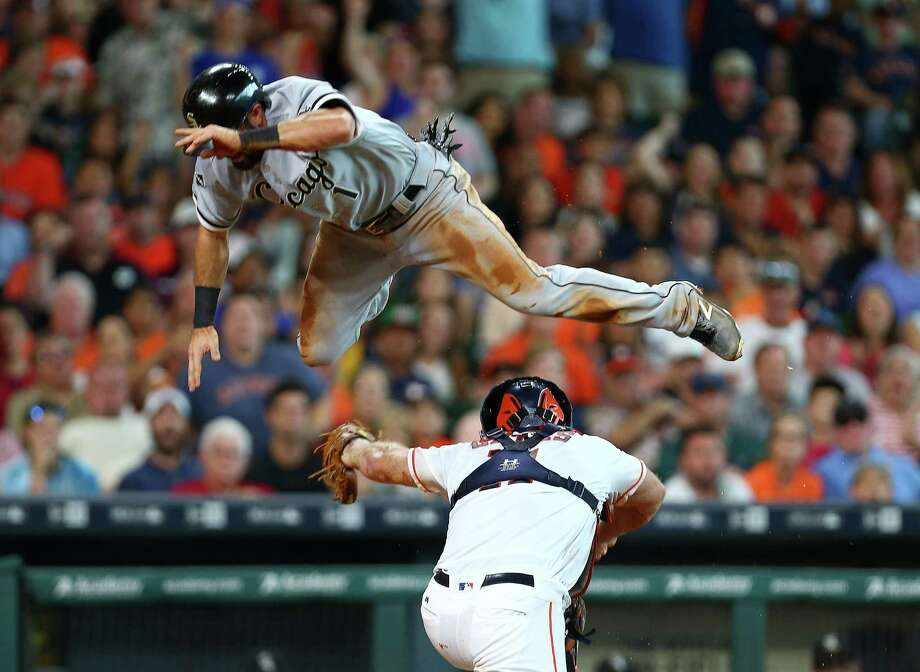 The White Sox's Adam Eaton is tagged out at home by Astros catcher Evan Gattis despite a valiant leap to avoid the tag in the third inning of Saturday's game. Photo: Jon Shapley, Staff / © 2015  Houston Chronicle