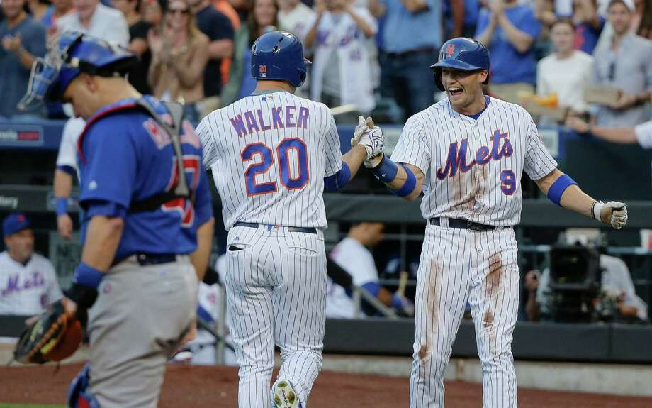 New York Mets' Neil Walker (20) is greeted by Brandon Nimmo (9) after hitting a two-run home run against the Chicago Cubs during the first inning of a baseball game, Saturday, July 2, 2016, in New York. (AP Photo/Julie Jacobson) ORG XMIT: NYJJ101 Photo: Julie Jacobson / Copyright 2016 The Associated Press. All rights reserved. This m