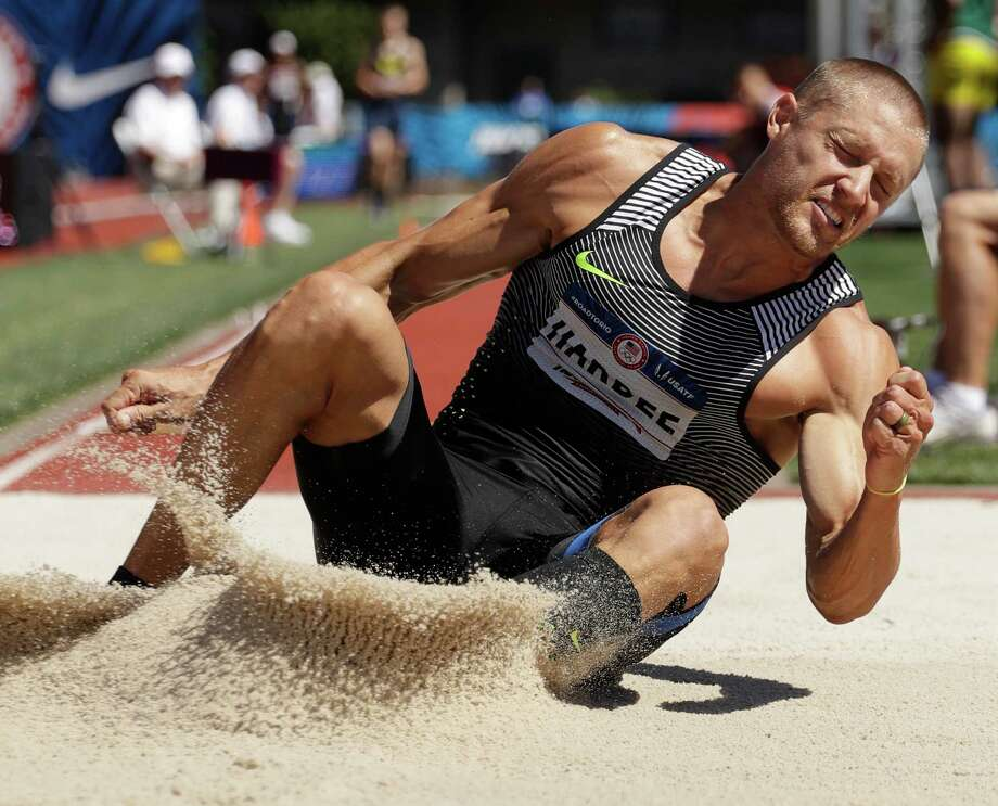 Trey Hardee lands during the decathlon long jump event at the U.S. Olympic Track and Field Trials, Saturday, July 2, 2016, in Eugene Ore. (AP Photo/Charlie Riedel) ORG XMIT: ORCC113 Photo: Charlie Riedel / AP