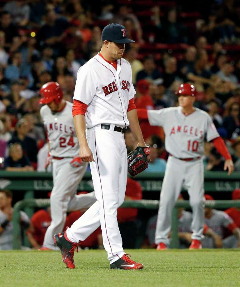Boston Red Sox's Pat Light walks back to the mound after giving up a two-run home run to Los Angeles Angels' C.J. Cron (24) during the seventh inning of a baseball game in Boston, Saturday, July 2, 2016. (AP Photo/Michael Dwyer) ORG XMIT: MAMD114 Photo: Michael Dwyer / Copyright 2016 The Associated Press. All rights reserved. This m