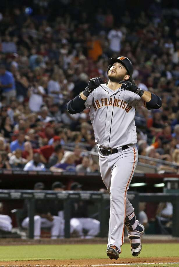 Brandon Crawford points to the sky after his fourth-inning homer. Photo: Ross D. Franklin, Associated Press