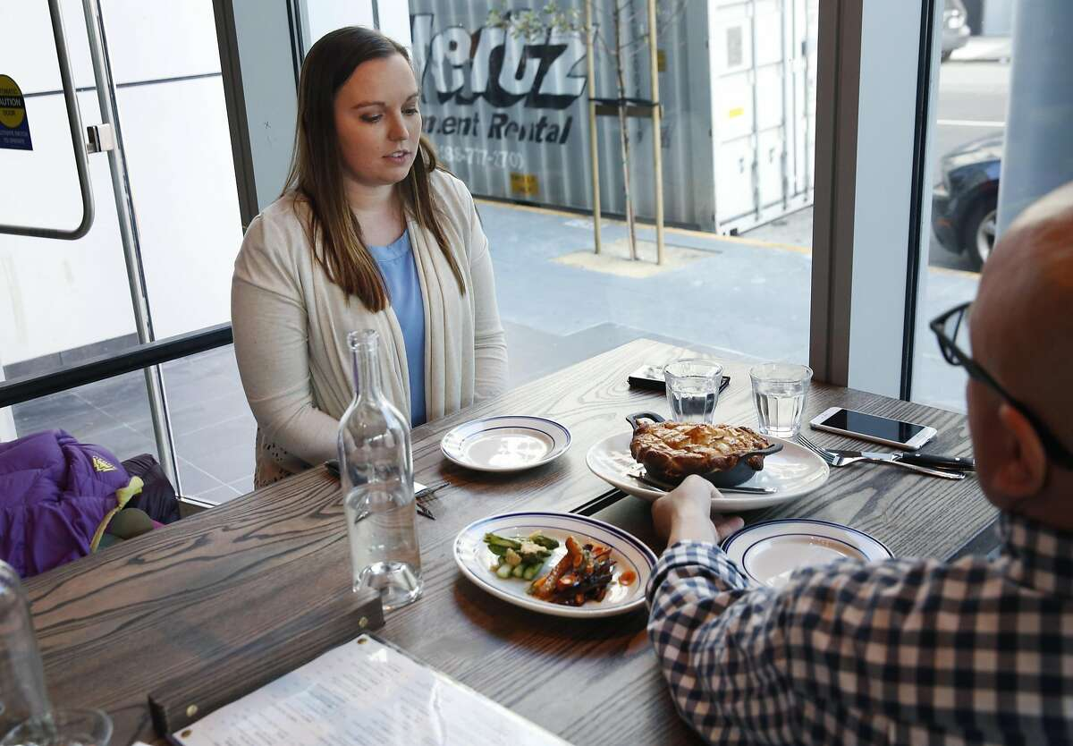 Christa and Tim Laughland (Tim not pictured) get their order of pot pie and asparagus a la plancha and roasted carrots with pesto from server Jair Solano in Corridor July 1, 2016 in San Francisco, Calif.