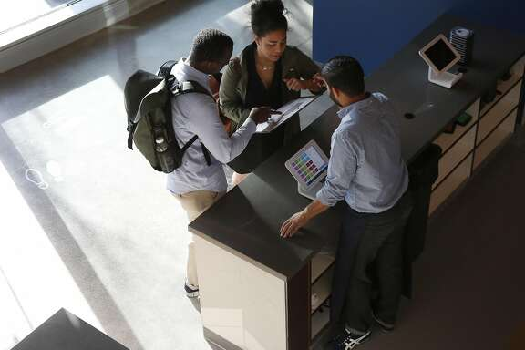 Akeel Shah helps Lauren Jones, right, and Rodney Lewis with their order in Corridor July 1, 2016 in San Francisco, Calif.