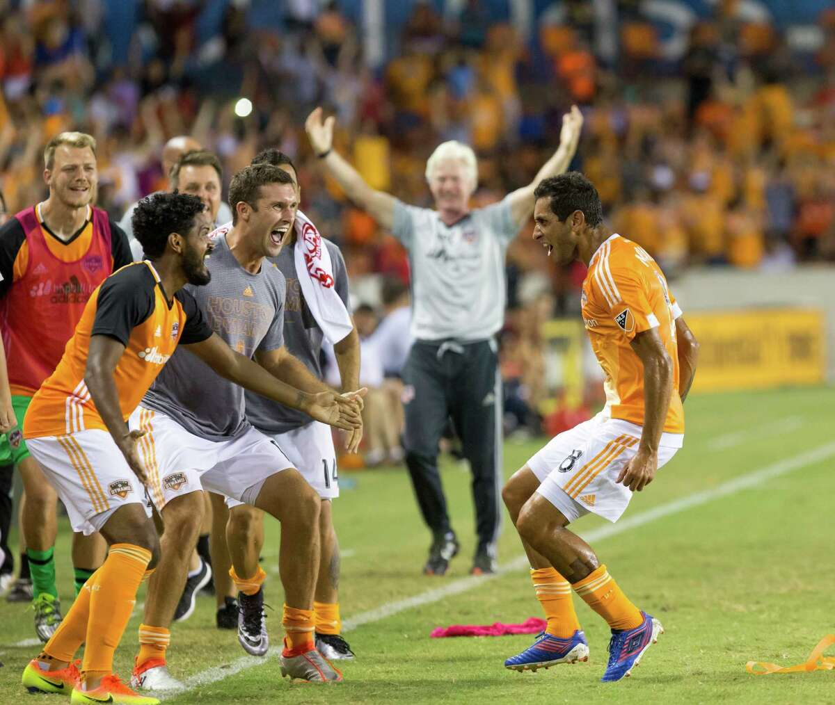 Houston Dynamo midfielder Cristian Maidana (8) celebrates with teammates after scoring in the free kick during the second half of action between the between the Houston Dynamo and the Philadelphia Union during an MLS soccer game at BBVA Compass, Saturday, July 02, 2016, in Houston. Houston Dynamo defeated Philadelphia Union 1-0. (Juan DeLeon/for the Houston Chronicle )