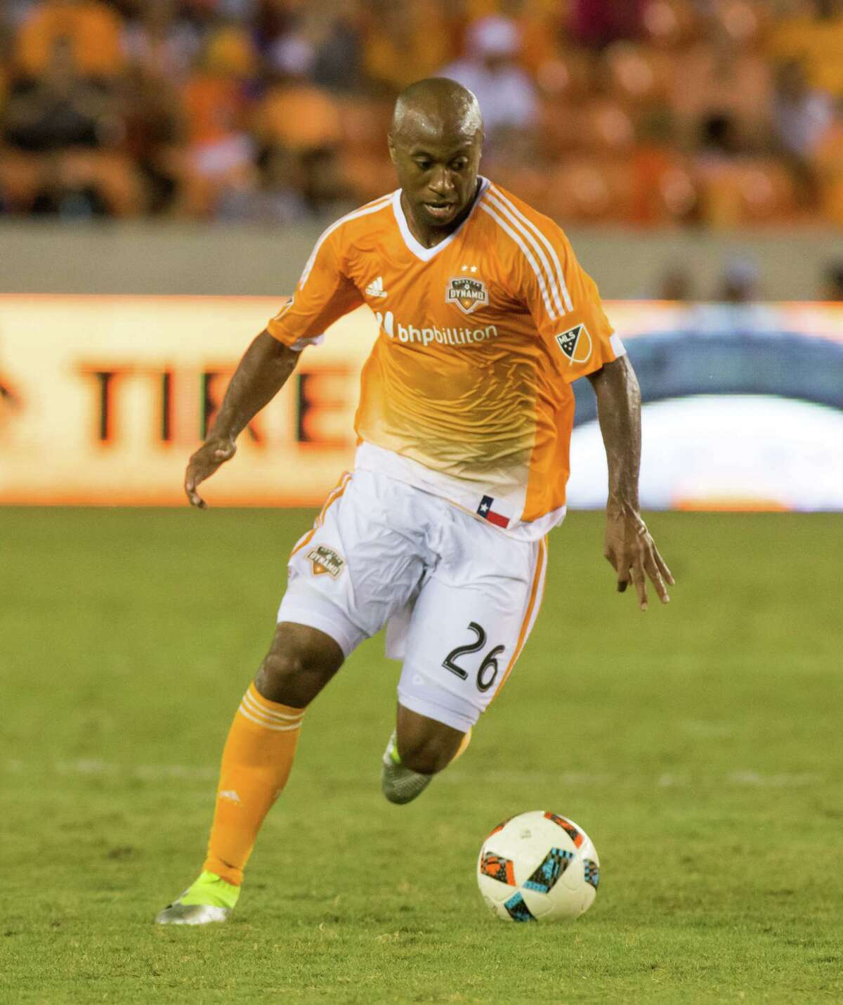 Houston Dynamo midfielder Collen Warner (26) pushing the ball during the second half of action between the between the Houston Dynamo and the Philadelphia Union during an MLS soccer game at BBVA Compass, Saturday, July 02, 2016, in Houston. Houston Dynamo defeated Philadelphia Union 1-0. (Juan DeLeon/for the Houston Chronicle )