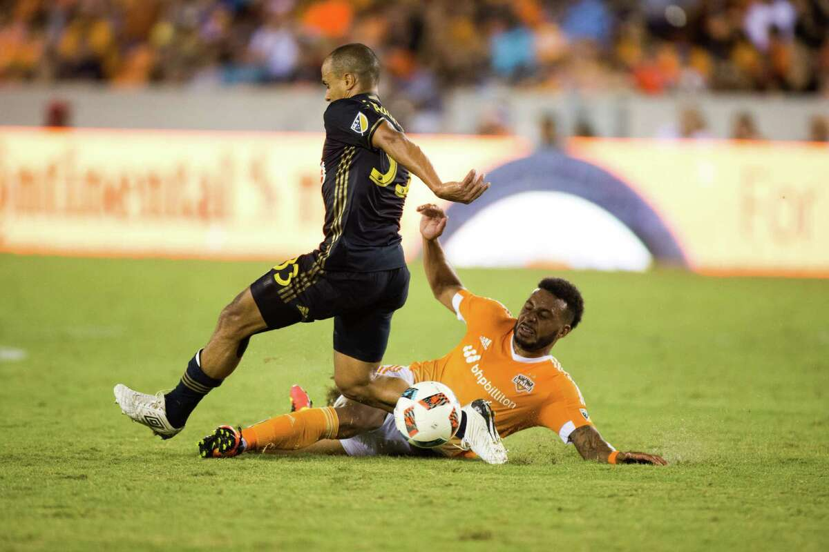 Houston Dynamo forward Giles Barnes (10) slides to sweep the ball away from Philadelphia Union defender Fabinho (33)during the second half of action between the between the Houston Dynamo and the Philadelphia Union during an MLS soccer game at BBVA Compass, Saturday, July 02, 2016, in Houston. Houston Dynamo defeated Philadelphia Union 1-0. (Juan DeLeon/for the Houston Chronicle )