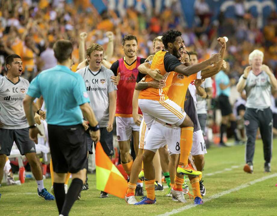Houston Dynamo midfielder Cristian Maidana (8) celebrates with Houston Dynamo midfielder Sheanon Williams (22) after scoring in the free kick during the second half of action between the between the Houston Dynamo and the Philadelphia Union during an MLS soccer game at BBVA Compass, Saturday, July 02, 2016, in Houston. Houston Dynamo defeated Philadelphia Union 1-0. (Juan DeLeon/for the Houston Chronicle ) Photo: Juan DeLeon, For The Chronicle / Houston Chronicle