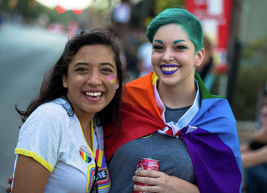 "Many in San Antonio turned out for the city's 2016's gay Pride Festival and Parade at Crockett Park and downtown on Saturday to show support and love for the LGBTQ community. This year's theme was ""Peace. Love. Pride."" Photo: By B. Kay Richter, For MySA.com"