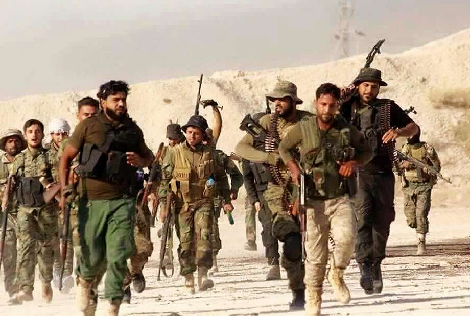 Members of the New Syrian Army, a rebel force, train last month in Syria. The fighters recently failed to capture the town of Boukamal, a prized possession of the Islamic State group. Photo: Uncredited, Associated Press