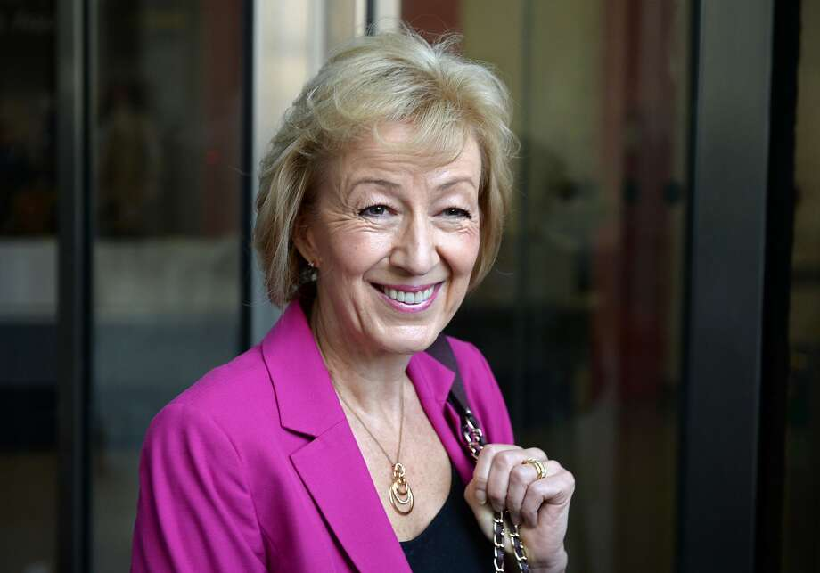 """British Conservative party leadership candidate Andrea Leadsom stops to pose for photographers as she arrives at the BBC television centre in London to appear on """"The Andrew Marr Show"""" in London on July 3, 2016. British media reported Saturday that energy minister and Brexit backer Angela Leadsom has become the favourite to face Theresa May on the ballot paper. / AFP PHOTO / CHRIS J RATCLIFFECHRIS J RATCLIFFE/AFP/Getty Images Photo: CHRIS J RATCLIFFE, AFP/Getty Images"""
