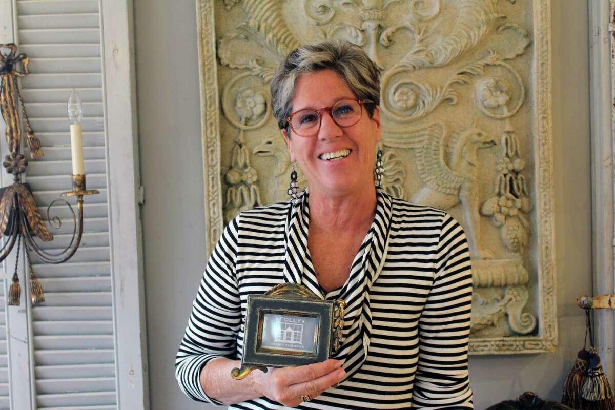 Lynn Hamlen, owner of Folly Design Elements on Post Road in Darien, is shown Tuesday, June 28, 2016.