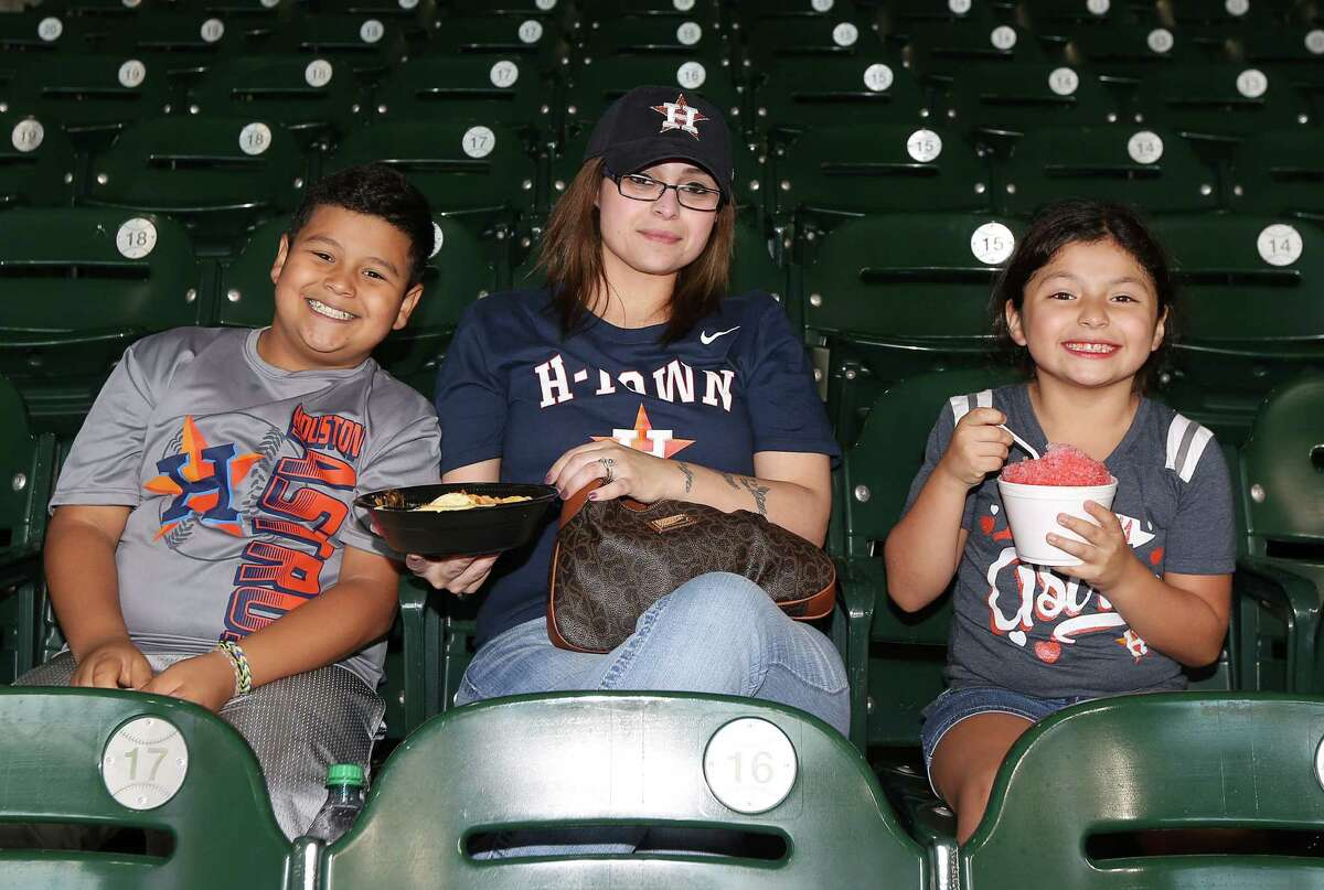 People pose for a photo before an MLB game at Minute Maid Park, Sunday, July 3, 2016, in Houston.