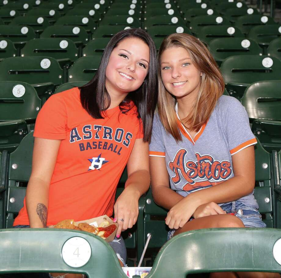 People pose for a photo before an MLB game at Minute Maid Park, Sunday, July 3, 2016, in Houston. Photo: Jon Shapley, Houston Chronicle / © 2015  Houston Chronicle