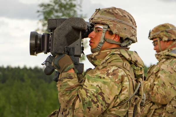Army Pvt. Joseph Morales, foreground, uses a command launch unit to look for his target during Saber Strike 16 in Tapa, Estonia, June 20, 2016. Morales is a cavalry scout assigned to the 2nd Cavalry Regiment.