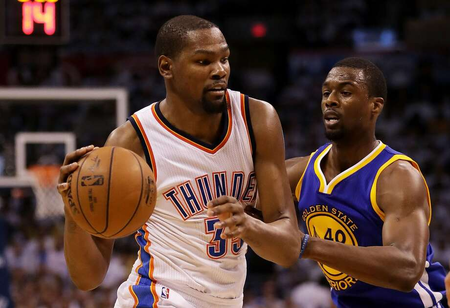 OKLAHOMA CITY, OK - MAY 24:  Kevin Durant #35 of the Oklahoma City Thunder drives against Harrison Barnes #40 of the Golden State Warriors in the third quarter in game four of the Western Conference Finals during the 2016 NBA Playoffs at Chesapeake Energy Arena on May 24, 2016 in Oklahoma City, Oklahoma. NOTE TO USER: User expressly acknowledges and agrees that, by downloading and or using this photograph, User is consenting to the terms and conditions of the Getty Images License Agreement.  (Photo by Ronald Martinez/Getty Images) Photo: Ronald Martinez, Getty Images