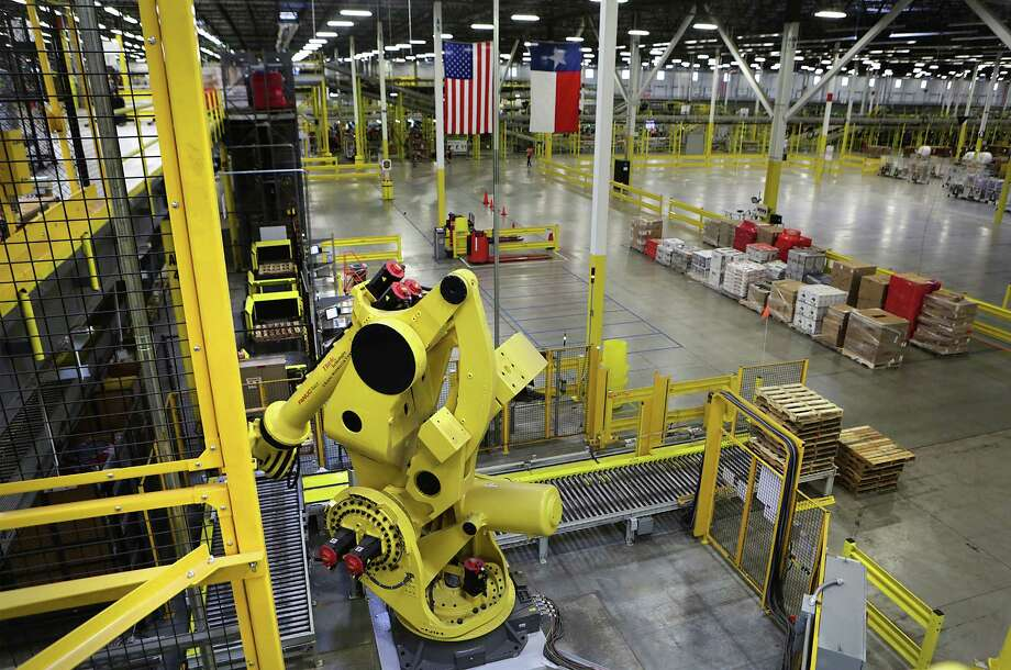 A 6-ton mechanical arm called Robo-Stow is one of the Kiva robots at the Amazon fulfillment center in Schertz. In 2012, bought Kiva and its robot legions. Jeff Bezos decided to use the robots for Amazon and Amazon alone. It's taken four years, but a handful of startups are finally ready to replace Kiva and equip the world's warehouses with new robotics. Photo: File Photo /San Antonio Express-News / © 2015 San Antonio Express-News