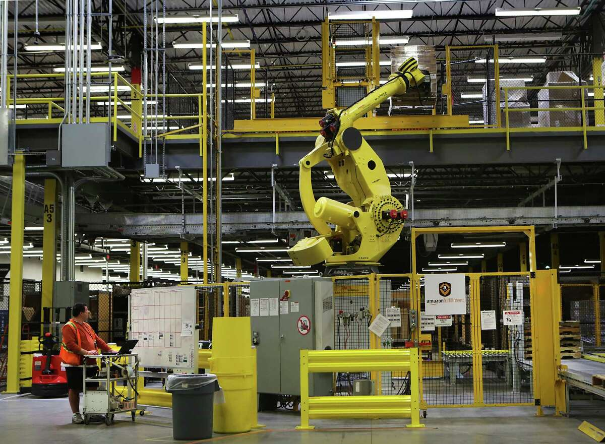Amazon has about 30,000 Kiva robots scuttling about its warehouses across the globe, including the one in Schertz. Dave Clark, the retailer's senior vice president of worldwide operations and customer service, estimated the addition of the bots reduced operating expenses by about 20 percent.