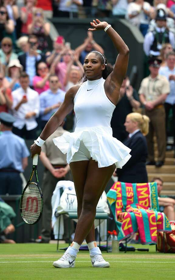 Serena Williams celebrates beating Germany's Annika Beck during their women's singles third round match on the seventh day of the 2016 Wimbledon Championships at The All England Lawn Tennis Club in Wimbledon, southwest London, on July 3, 2016. / AFP PHOTO / GLYN KIRK / RESTRICTED TO EDITORIAL USEGLYN KIRK/AFP/Getty Images Photo: GLYN KIRK, AFP/Getty Images
