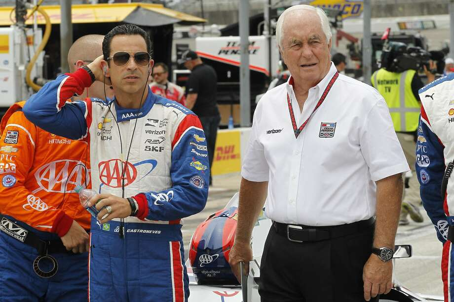 Helio Castroneves of Brazil and Roger Penske, right, walk on pit row before the start of an IndyCar auto race at Texas Motor Speedway, Sunday, June 12, 2016, in Fort Worth, Texas. (AP Photo/Tim Sharp) Photo: Tim Sharp, Associated Press