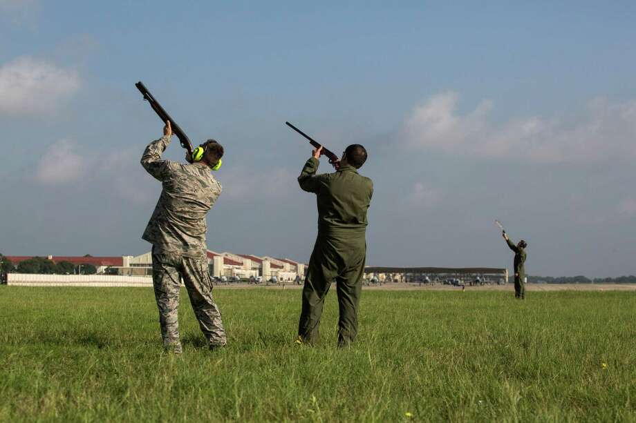 Universal City, Texas -- June 15, 2016 --  From left, Master Sgt. John Reagan, Maj. Will Roseand Maj. Chris Bernardo fire non-lethal ammo at birds to deter them from entering the flight pathat Randolph Air Force Base. Ray Whitehouse/for the San Antonio Express-News Photo: Ray Whitehouse, Photographer / For The San Antonio Express-News