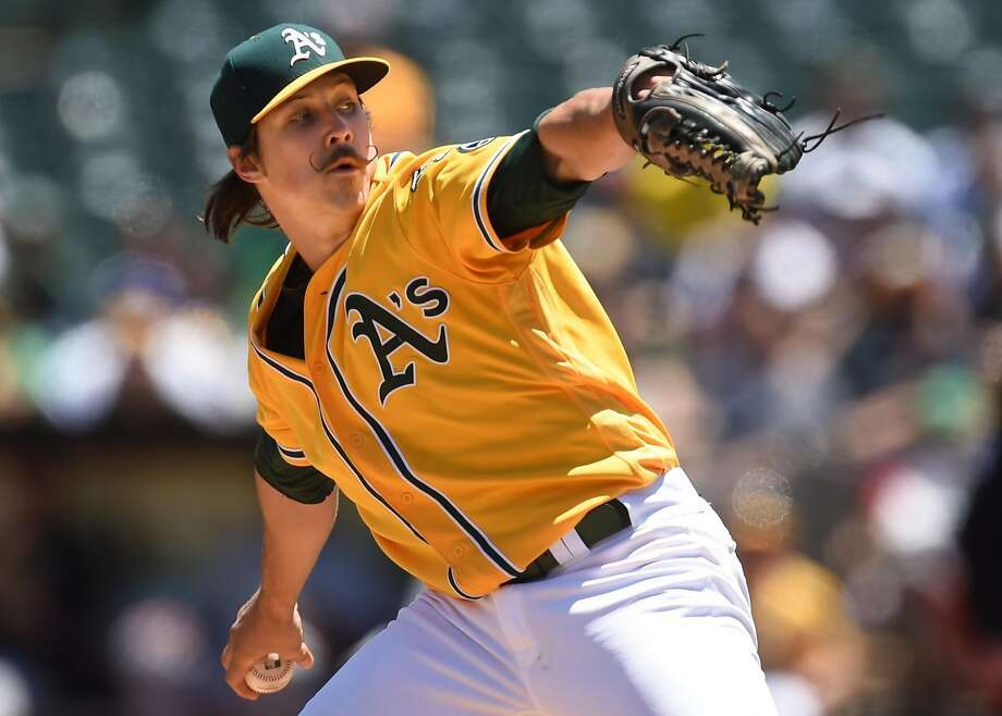 Oakland Athletics' Daniel Mengden pitches against the Pittsburgh Pirates during the first inning on Sunday at O.co Coliseum in Oakland. Photo: SUSAN TRIPP POLLARD, TNS