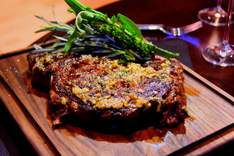 20-ounce grassfed ribeye, $48. Steaks are slathered with roasted-garlic beurre noisette. Photo: Steve Barnes