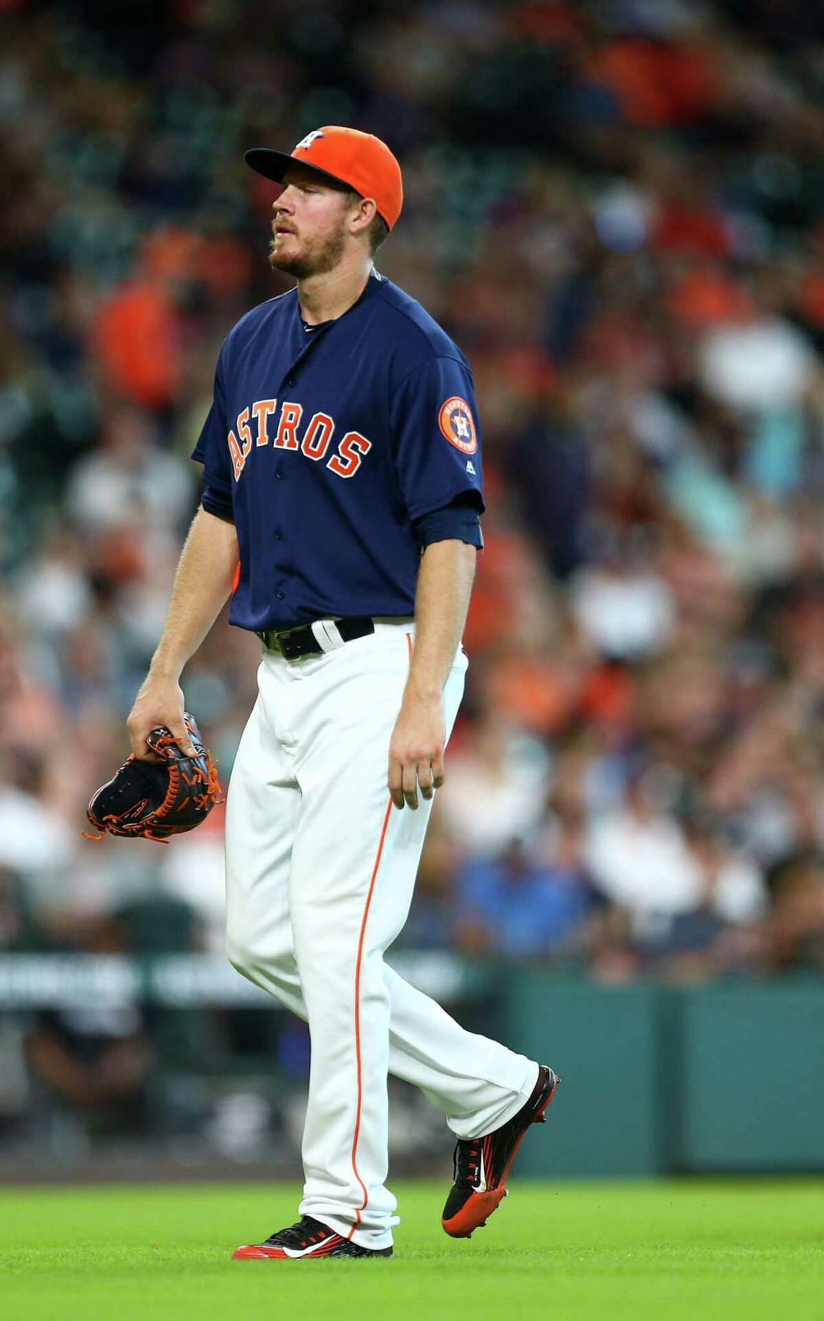 Houston Astros relief pitcher Chris Devenski (47) walks back to the dugout after being relieved by relief pitcher Luke Gregerson (44) during the eighth inning of an MLB game at Minute Maid Park, Sunday, July 3, 2016, in Houston.