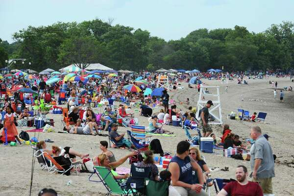 Calf Pasture Beach was packed with people before Norwalk's annual 4th of July fireworks display on Sunday, July 3, 2016.