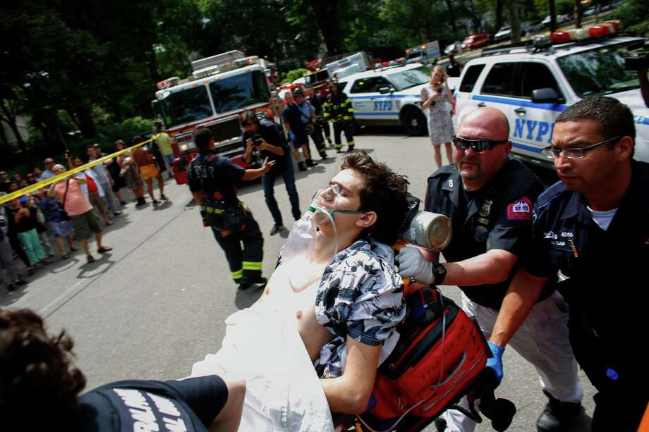 Connor Goldman, 18, receives aid after he jumped on explosive material that had been left in Central Park. His left leg below the knee had to be amputated. Photo: KENA BETANCUR, Stringer / AFP or licensors