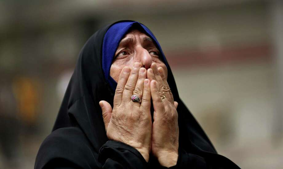 An Iraqi woman grieves at the scene after a car bomb attack Sunday in Baghdad that killed at least 143. Photo: Hadi Mizban, STF / Copyright 2016 The Associated Press. All rights reserved. This material may not be published, broadcast, rewritten or redistribu
