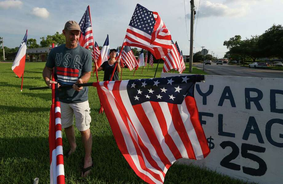 Larry Westfall and his wife, Lesli, have sold U.S. flags on the corner of FM518 and Butler in downtown League City since 1991. Photo: Steve Gonzales / © 2016 Houston Chronicle