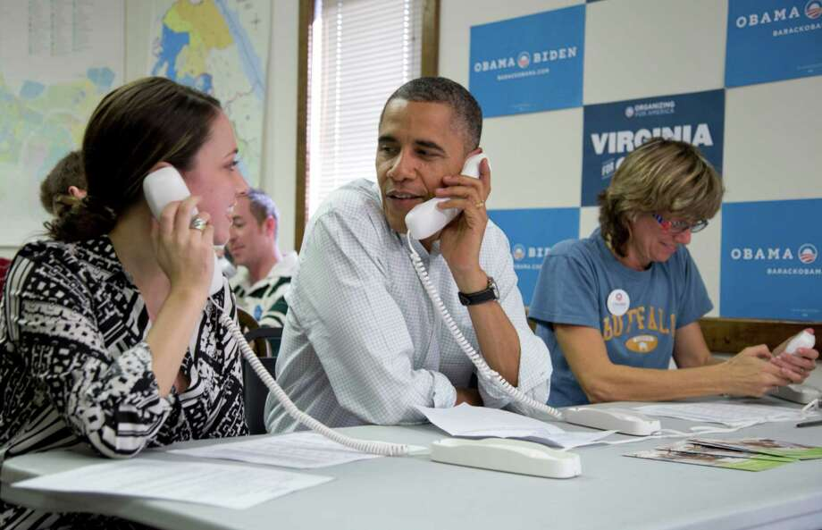 FILE - In this Oct. 14, 2012, file photo, President Barack Obama makes phone calls to volunteers at a Obama campaign office with Alexa Kissinger, left, and, Suzanne Stern, right, in Williamsburg, Va. The vaunted data-driven machine that twice got Obama elected is dusting itself off to help elect Hillary Clinton, as Democrats look to recreate the tactical advantage they used against Republicans in 2008 and 2012.(AP Photo/Carolyn Kaster, File) ORG XMIT: WX202 Photo: Carolyn Kaster / AP2012