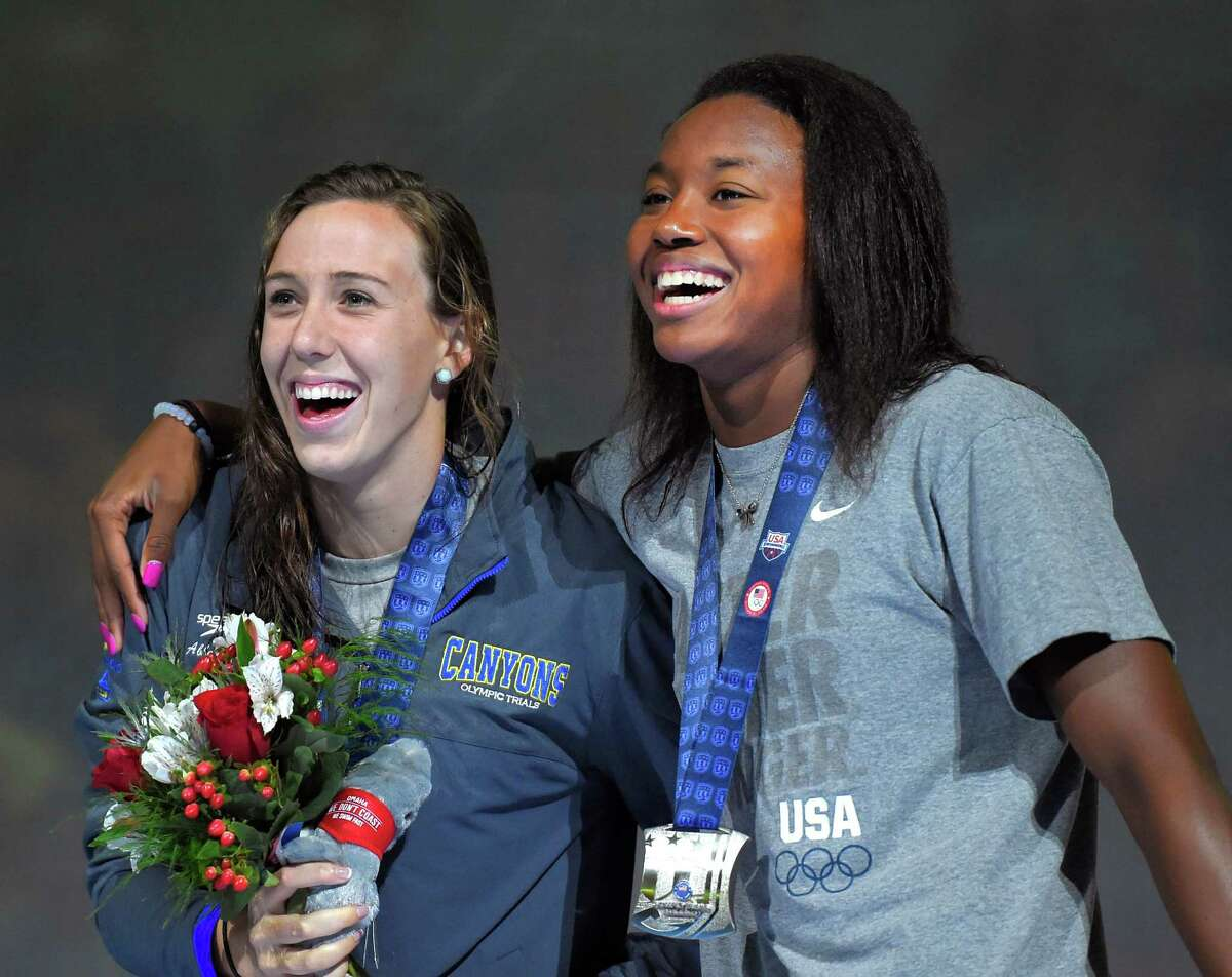 With the pressure off, Abbey Weitzeil, left, and Simone Manuel can enjoy their 1-2 finish in the women's 50-meter freestyle event Sunday.