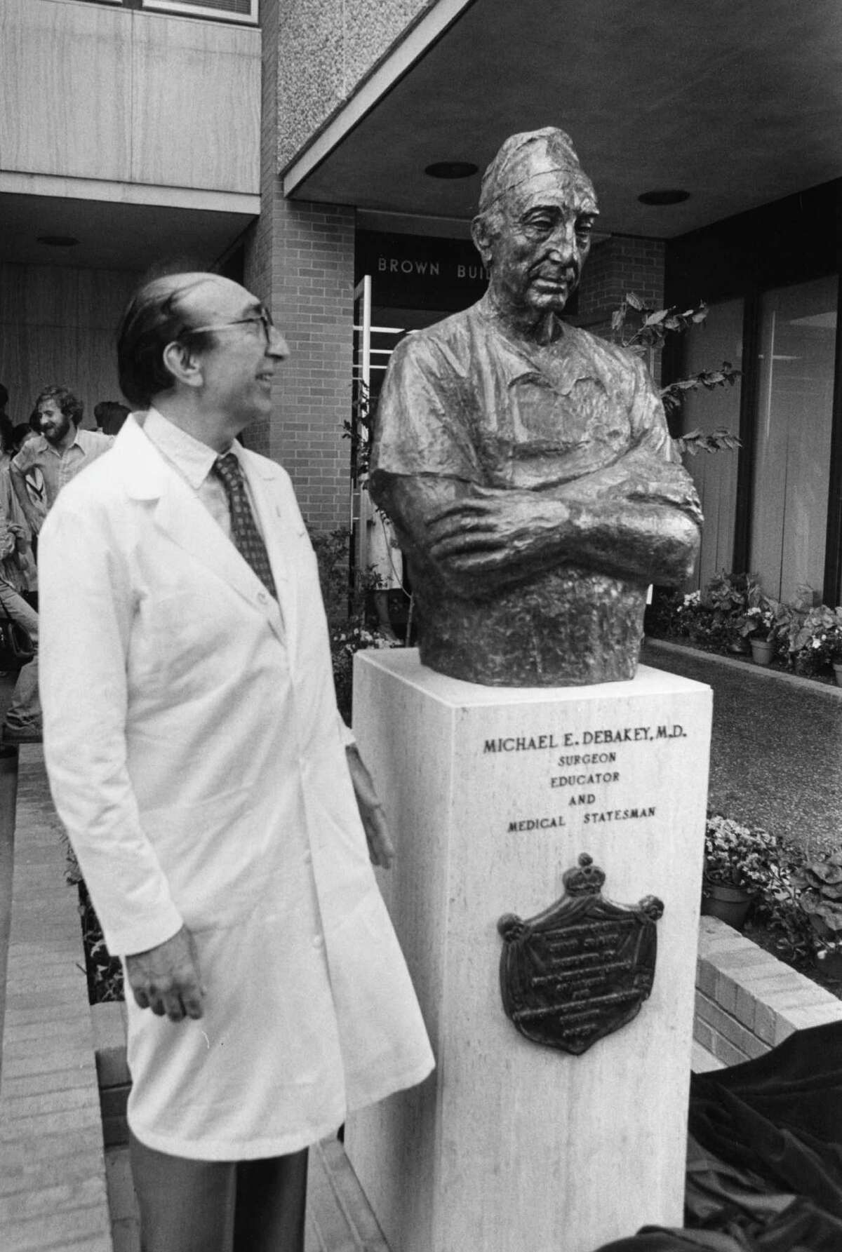 05/12/1978 -- Heart surgeon Dr. Michael DeBakey stands beside the bust of himself at the Brown Cardiovascular Research and Training Center. (Houston Post file photo)