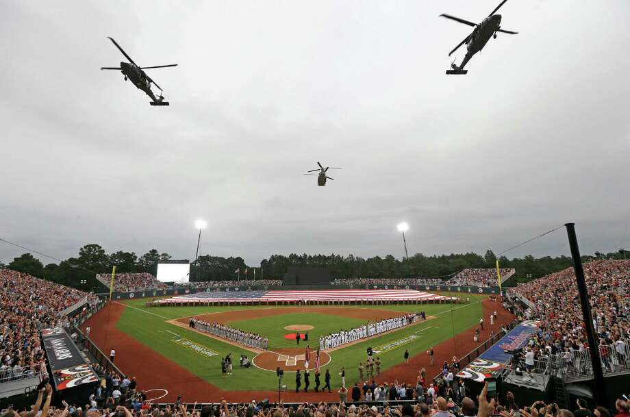 Helicopters fly over Fort Bragg Field prior to Sunday night's major league game between the Miami Marlins and Atlanta Braves in Fort Bragg, N.C. Photo: Gerry Broome, STF / Copyright 2016 The Associated Press. All rights reserved. This material may not be published, broadcast, rewritten or redistribu