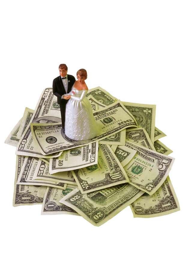 wedding cost. la voz / jupiterimagesunlimited