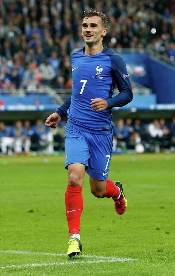 France's Antoine Griezmann celebrates after scoring his side's fourth goal during the Euro 2016 quarterfinal soccer match between France and Iceland, at the Stade de France in Saint-Denis, north of Paris, France, Sunday, July 3, 2016. (AP Photo/Thibault Camus) ORG XMIT: FP152 Photo: Thibault Camus / AP