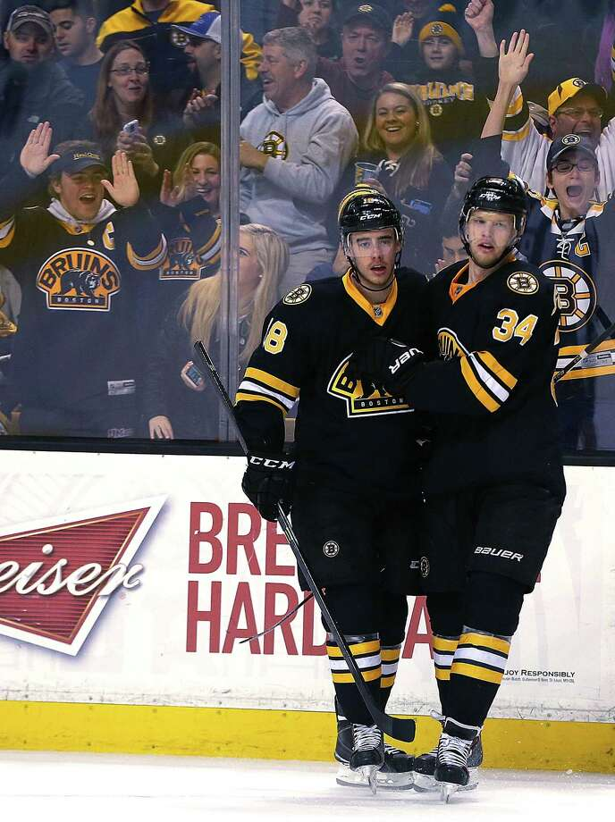 BOSTON, MA - MARCH 28:  Reilly Smith #18 of the Boston Bruins celebrates a goal by Carl Soderberg #34 of the Boston Bruins in the first period against the New York Rangers at the TD Garden on March 28, 2015 in Boston, Massachusetts.  (Photo by Jim Rogash/Getty Images) ORG XMIT: 507051173 Photo: Jim Rogash / 2015 Getty Images