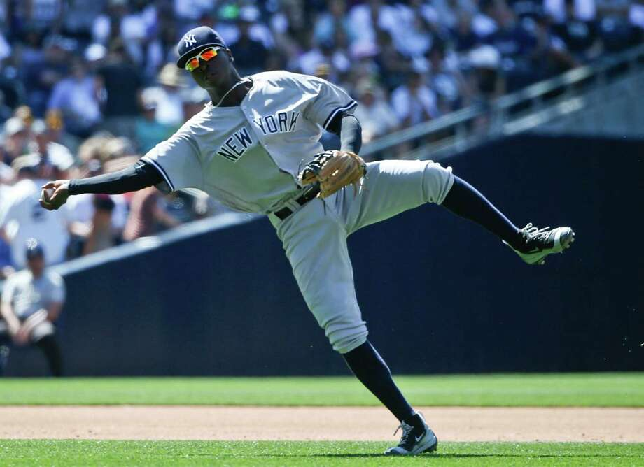 New York Yankees shortstop Didi Gregorius throws out San Diego Padres' Wil Myers at first after fielding a slow roller in the sixth inning of a baseball game Sunday, July 3, 2016, in San Diego. (AP Photo/Lenny Ignelzi) ORG XMIT: CALI109 Photo: Lenny Ignelzi / Copyright 2016 The Associated Press. All rights reserved. This m