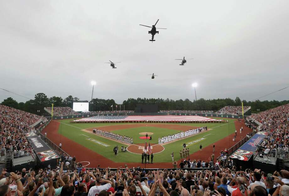 FORT BRAGG, NC - JULY 03:  A general view of helicopters flying over Fort Bragg Field prior to the game between the Miami Marlins and Atlanta Braves on July 3, 2016 in Fort Bragg, North Carolina. The Fort Bragg Game marks the first regular season MLB game ever to be played on an active military base.  (Photo by Streeter Lecka/Getty Images) ORG XMIT: 607681045 Photo: Streeter Lecka / 2016 Getty Images