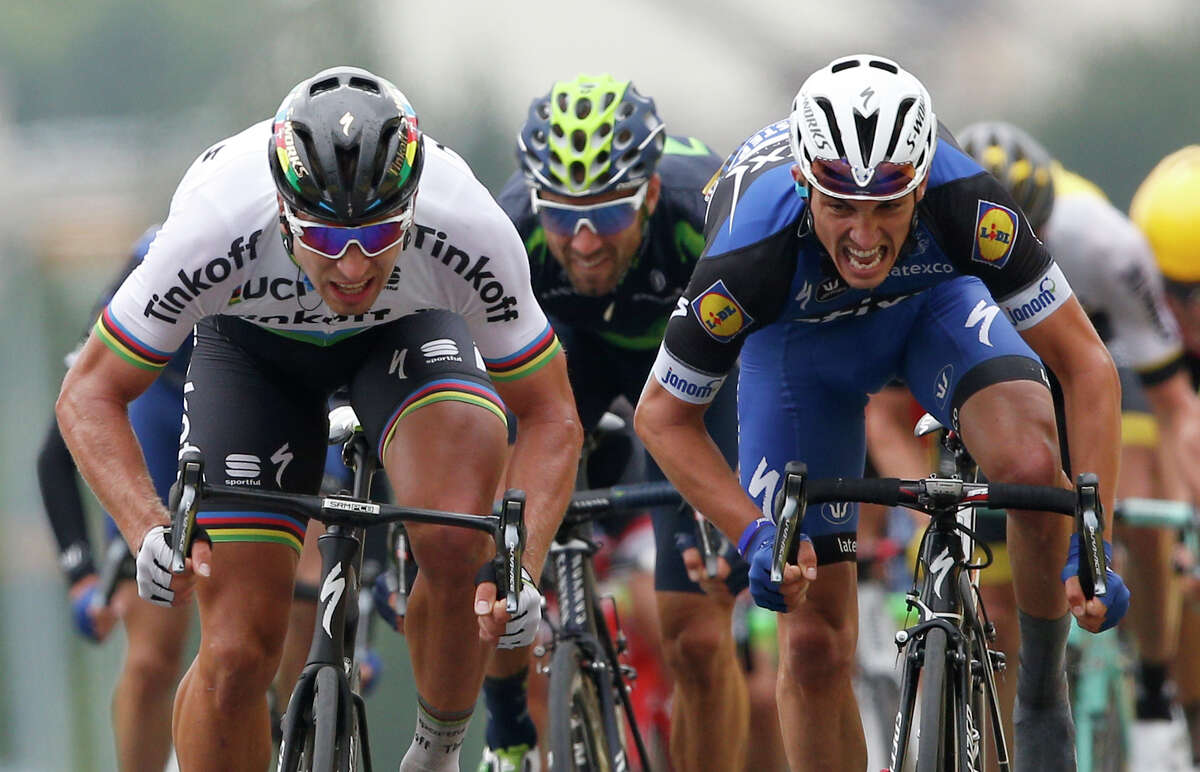 Peter Sagan of Slovakia, left, crosses the finish line ahead of France?'s Julian Alaphilippe, right, and Spain's Alejandro Valverde to win the second stage of the Tour de France cycling race over 183 kilometers (113.7 miles) with start in Saint-Lo and finish in Cherbourg-en-Cotentin, France, Sunday, July 3, 2016. (AP Photo/Christophe Ena) ORG XMIT: ENA123
