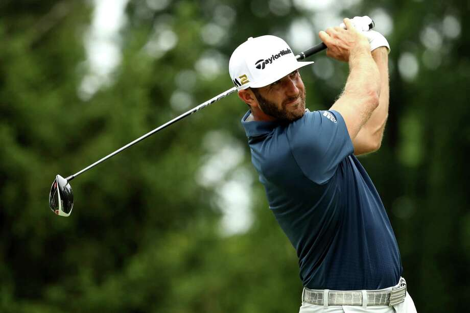 AKRON, OH - JULY 03: Dustin Johnson hits off the fourth tee during the final round of the World Golf Championships - Bridgestone Invitational at Firestone Country Club South Course on July 3, 2016 in Akron, Ohio.  (Photo by Mike Lawrie/Getty Images) ORG XMIT: 592319725 Photo: Mike Lawrie / 2016 Getty Images