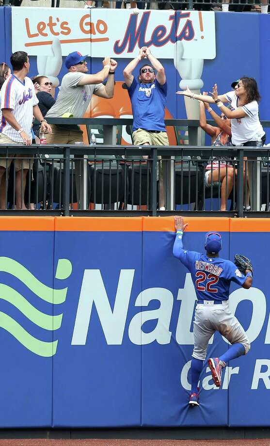 Chicago Cubs right fielder Jason Heyward, bottom, tries to catch a home run hit by New York Mets' Rene Rivera during the second inning of the baseball game Sunday, July 3, 2016, in New York. (AP Photo/Seth Wenig) ORG XMIT: NYSW107 Photo: Seth Wenig / Copyright 2016 The Associated Press. All rights reserved. This m