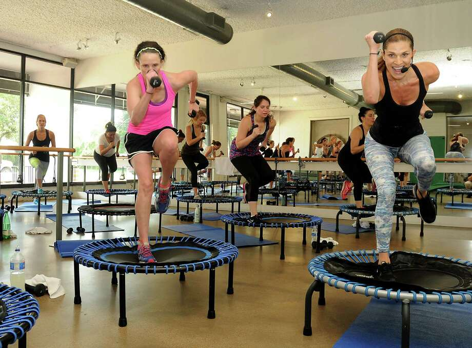 Working on a small trampoline, Alison Brookby leads a Bounce class at Define Mind & Body on Bissonnet. Photo: Dave Rossman, Freelance / Dave Rossman